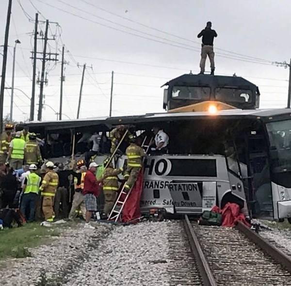 Train Hits Charter Bus_318803