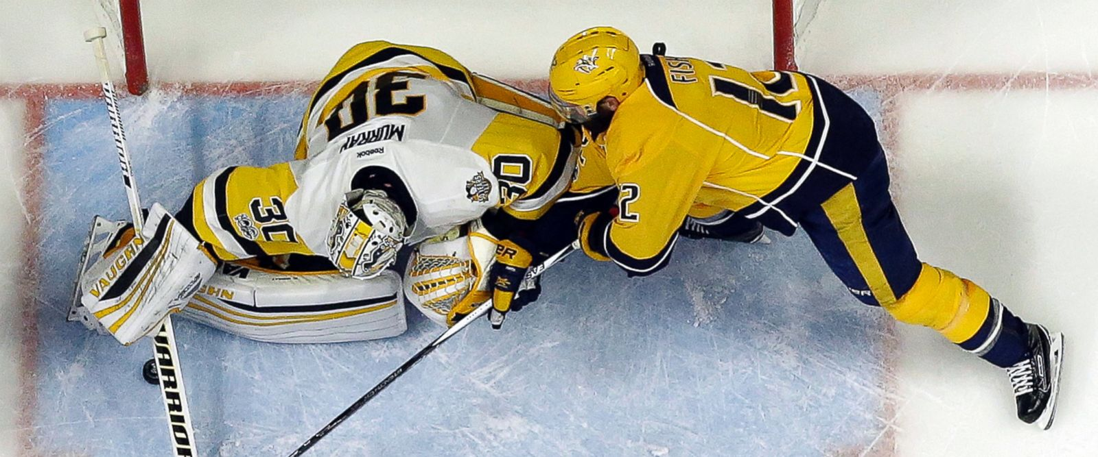Pittsburgh Penguins goalie Matt Murray (30) defends the goal against Nashville Predators' Mike Fisher (12) during the first period of Game 6 of_362650
