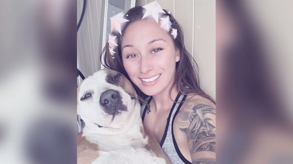 woman rides bike with dog_427724