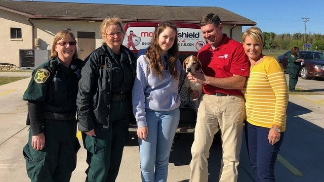 Animal Control Specialist Lynn Davidson, Supervisor Pam Waldron, and the Rodgers family reunited with Hannah_1521477750948.jpg_37700953_ver1.0_640_360_1521484087775.jpg.jpg