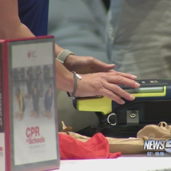 Bayside Academy receives lifesaving training kit after coach is saved by CPR
