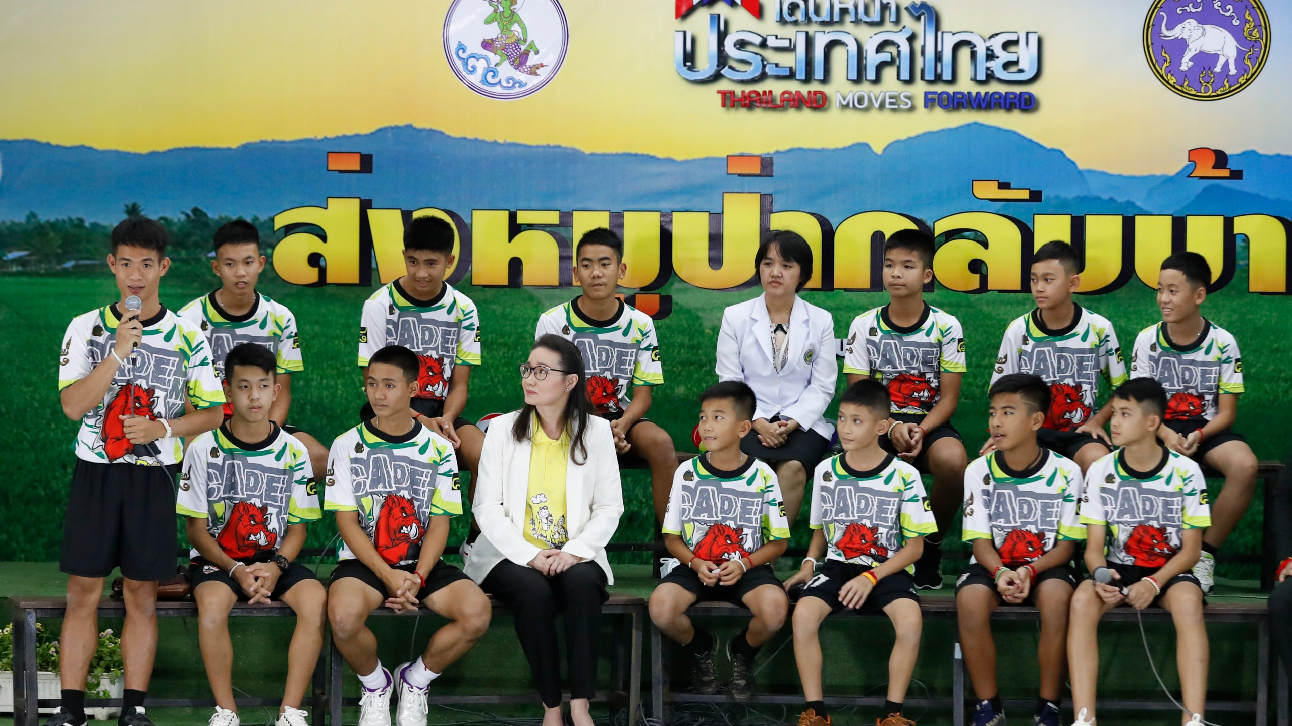 Thailand soccer team arrives at press conference.