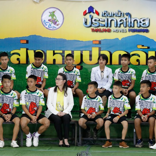Thailand soccer team arrives at press conference.