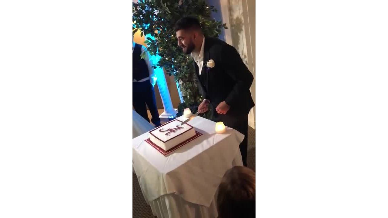 VIRAL VIDEO: Guests gasp as Alabama fan cuts groom cake