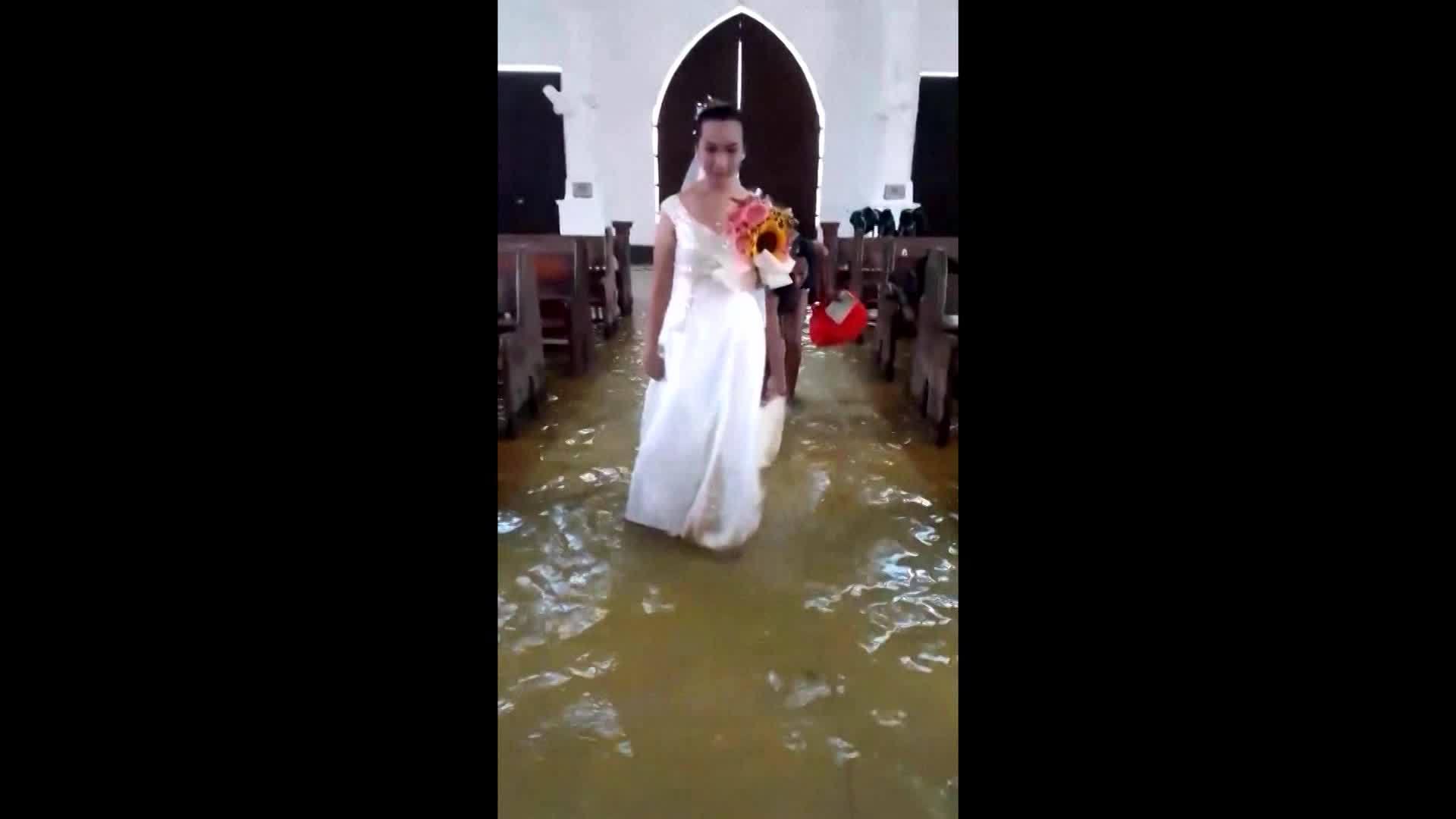VIDEO: Bride walks down aisle of flooded church