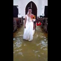 VIDEO: Bride walks down aisle of flooded church