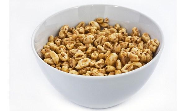 Light gray ceramic bowl of honey cereals_1534092483417