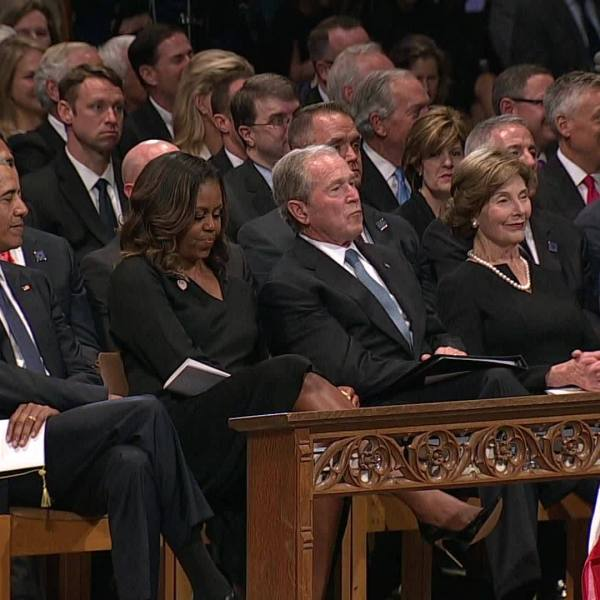 George Bush sneaks Michelle Obama candy during McCain funeral