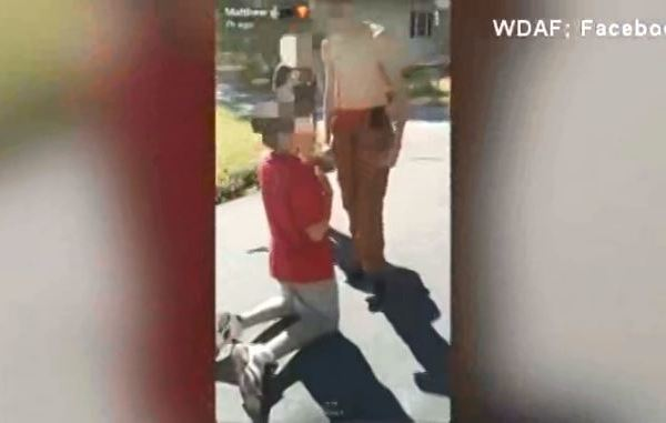 Shocking video shows bullies point gun at boy's head