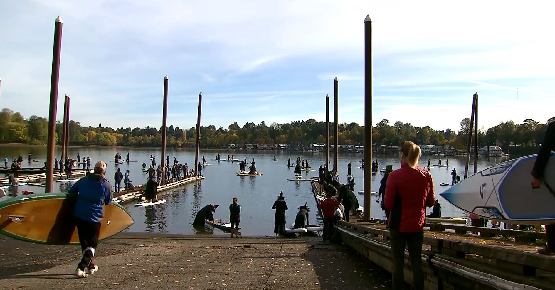 100s of Oregon 'witches' paddle down river, minus the brooms