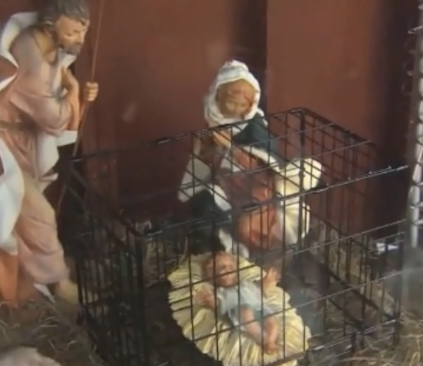 caged baby Jesus_1544308013357.jpg.jpg