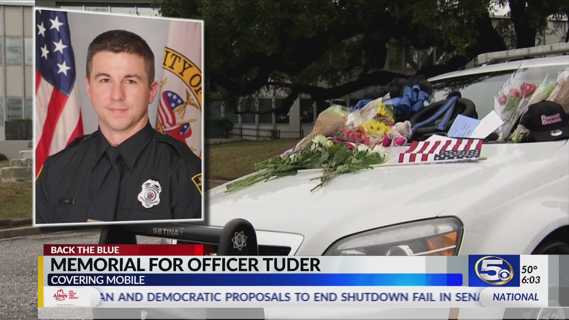 VIDEO: Community members leave mementos on patrol car in memory of Officer Tuder