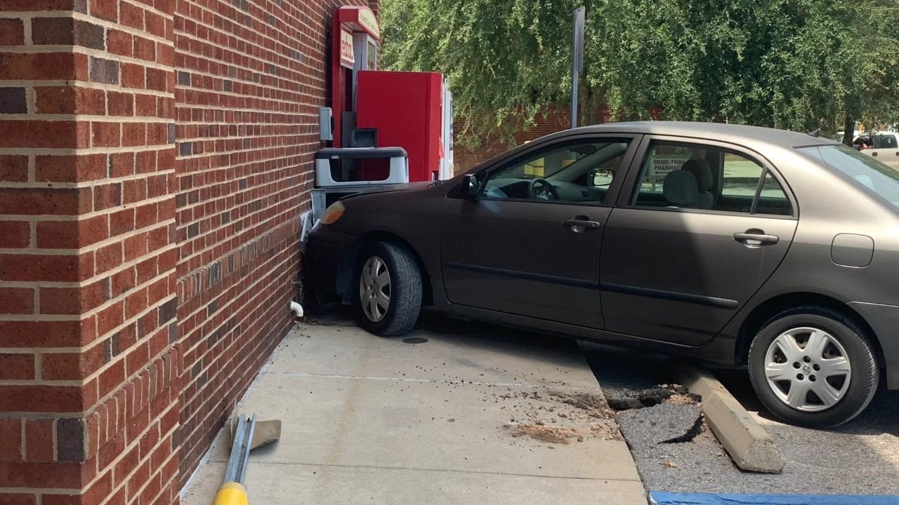 A sedan runs into the CVS pharmacy on Dauphin Street Tuesday