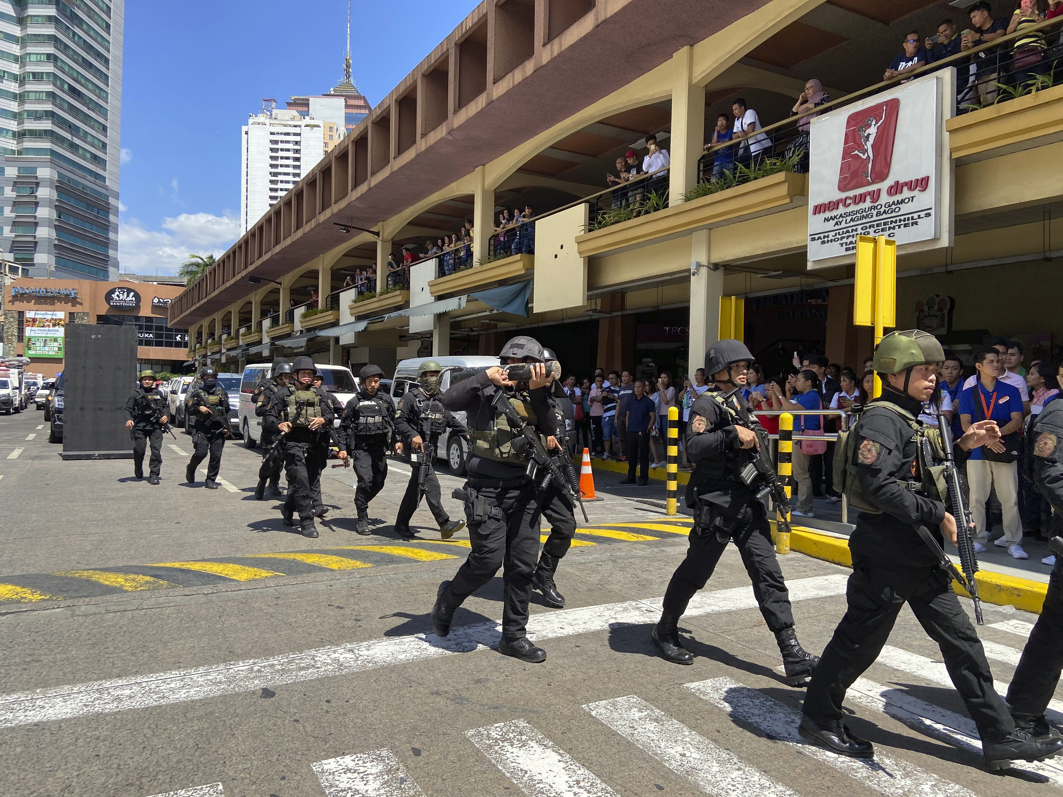 Ex guard frees dozens of hostages in Manila mall, is subdued