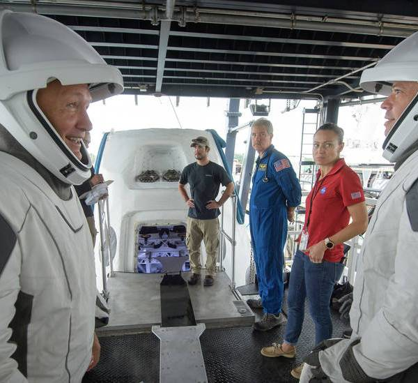 NASA astronauts Doug Hurley, left, and Bob Behnken rehearse crew extraction from SpaceX's Crew Dragon, which will be used to carry humans to the International Space Station, on August 13, 2019 at the Trident Basin in Cape Canaveral, Florida. Credits: NASA/Bill Ingalls