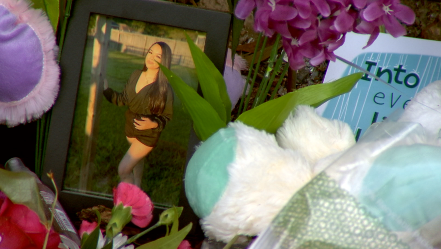 A frame with a photo of Rene Nguyen sits at the crash site (WKRG)