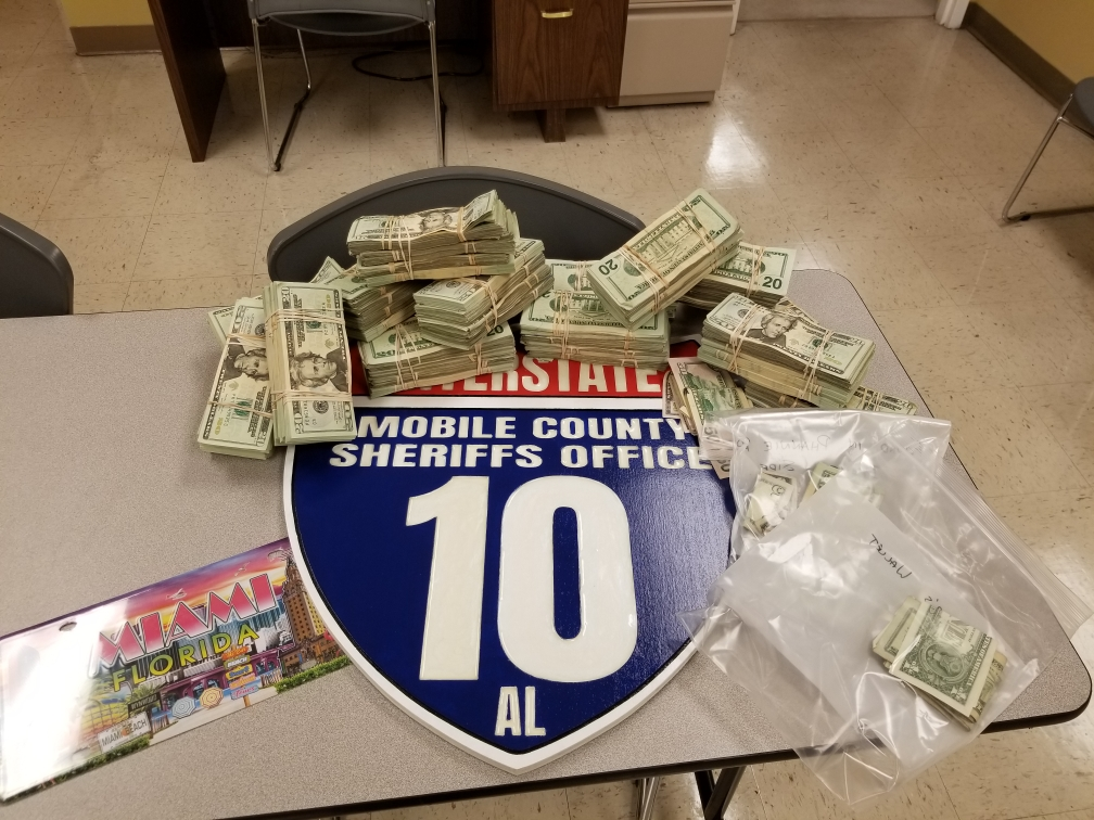 $120,000 stuffed in suitcase recovered from Mobile traffic stop